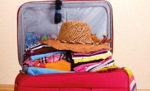 sognare valigia vestiti